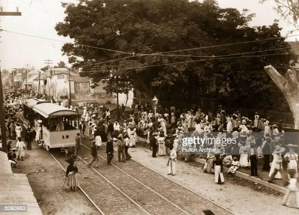 Railway and crowds in Grange Street Kingston Jamaica