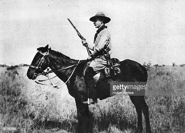 Robert BadenPowell sits upon his horse weapon in hand as 'The Defender of Mafeking' He later founded the Scout Association