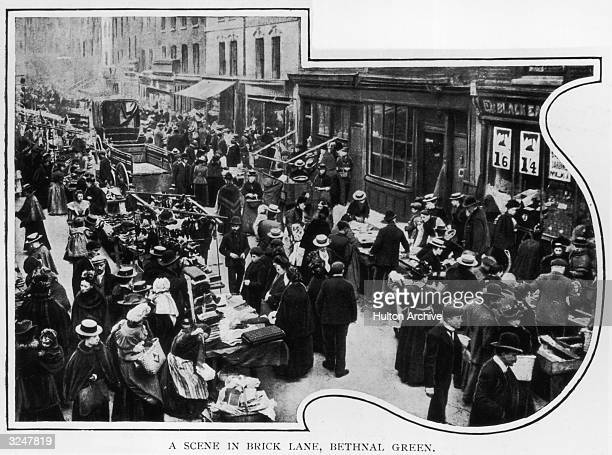 Shoppers at the clothes market in Brick Lane Bethnal Green east London