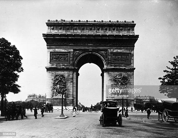 The Arc de Triomphe in the Place Charles de Gaulle Paris a triumphal monument commissioned by Napoleon in 1806
