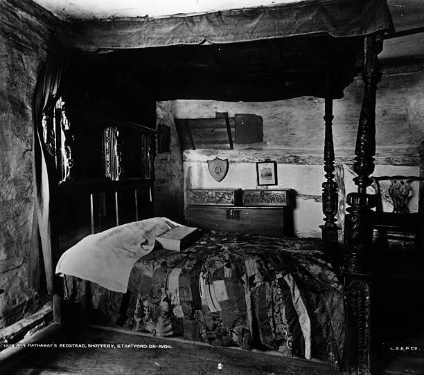 The bed in Anne Hathaway's cottage in Shottery, a village...