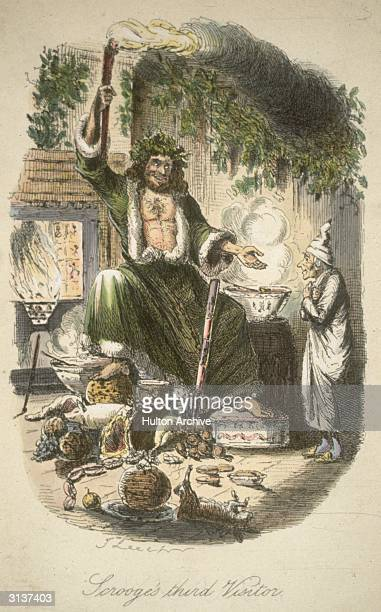 The Ghost of Christmas Present appears to the miserly Scrooge with a lavish Christmas spread in a scene from Charles Dickens' 'A Christmas Carol'...