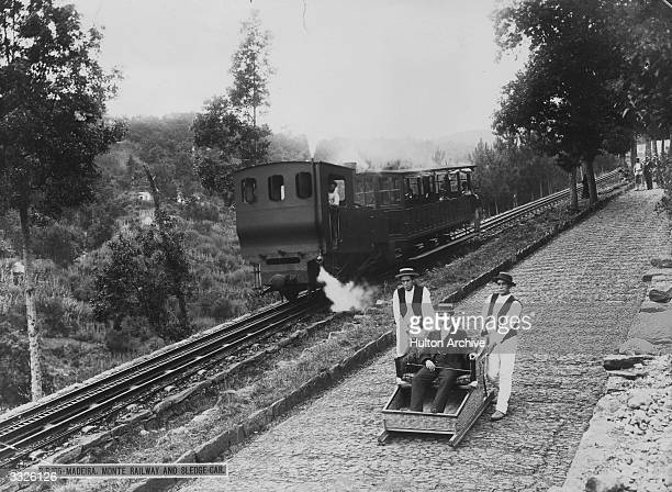 The mountain railway running alongside the 'slide' at Funchal Madeira 'Sledge cars' take the slope by two men on either side