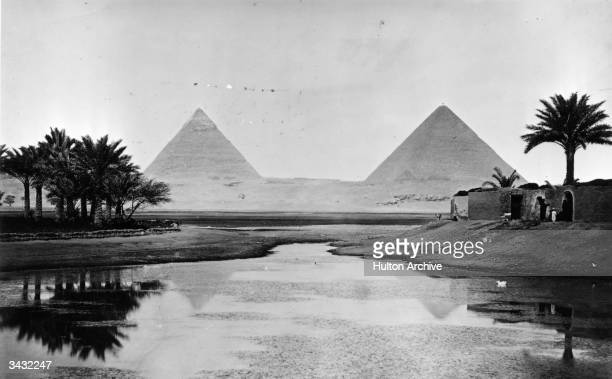 The pyramids at Giza on the banks of the River Nile built by the ancient Egyptians to house the bodies of their pharaohs