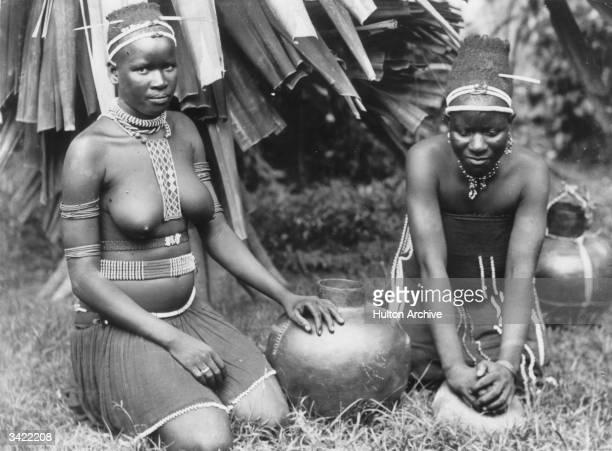 Women from a Zulu tribe preparing a meal.