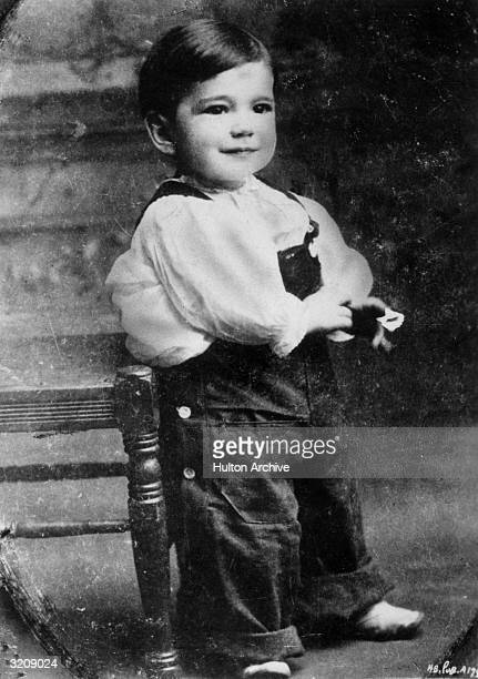 Full-length studio portrait of American actor Humphrey Bogart as a toddler in overalls.