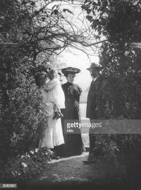 British statesman David Lloyd George stands among the trees with his first wife Margaret and daughters Mair and Megan