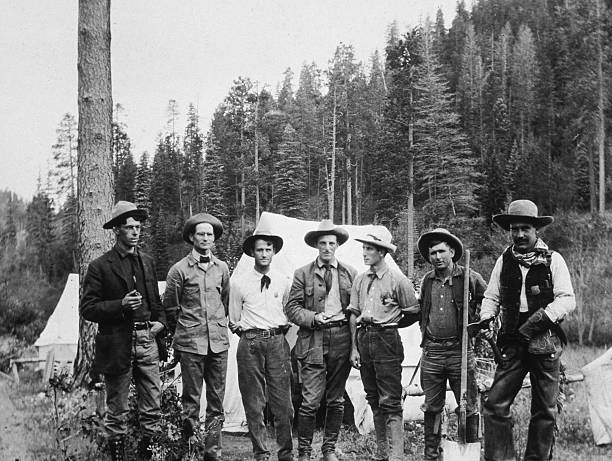 A group of mining prospectors pose in front of their...