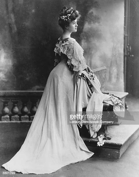 Actress Carol McComas wearing a fashionable dress with bustle lace collar and sleeves