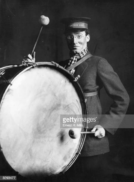 An actor playing a Salvation Army musician with a drum in George Bernard Shaw's 'Major Barbara'