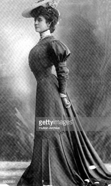 An Edwardian woman modelling a street dress in the typical style of the period