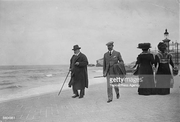 King Edward VII who ascended the British throne in 1901 walks on the seafront at Biarritz with a companion