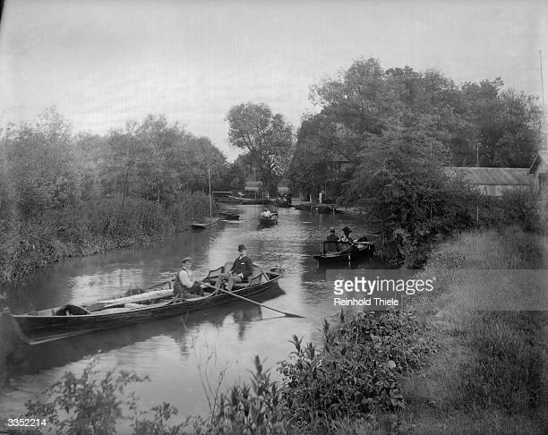 Rowers relax on the River Thames between Teddington and Surbiton