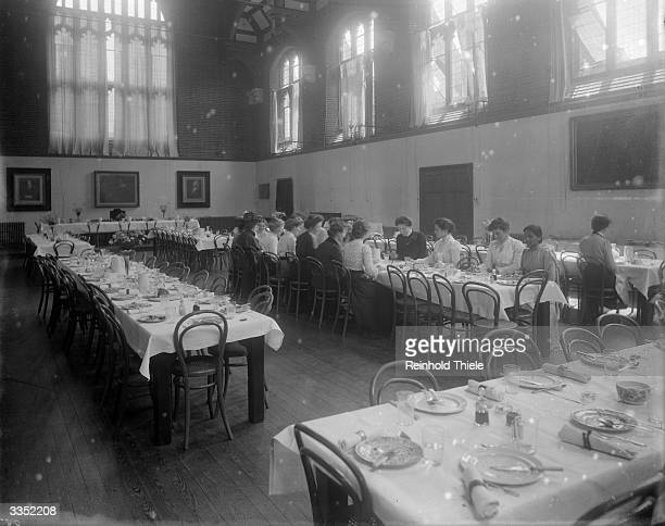 Students dining in Girton College at Cambridge University The college was founded in 1869 and was the first college for female undergraduates