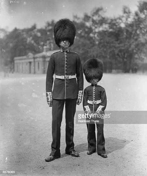 The tallest and shortest members of the Grenadier Guards wearing the bearskin cap given to the Guards in honour of their victory at the Battle of...