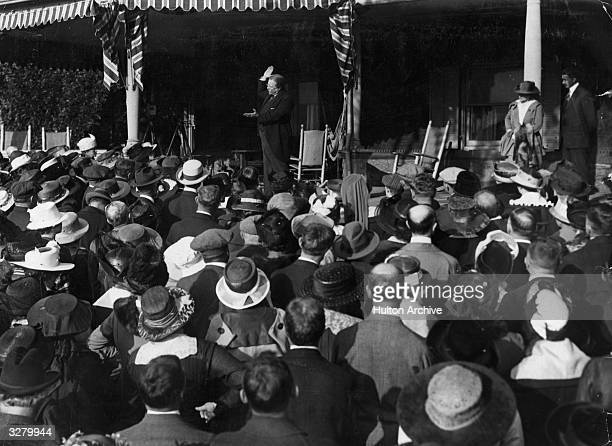 Theodore Roosevelt the 26th President of the United States addressing 500 suffragettes