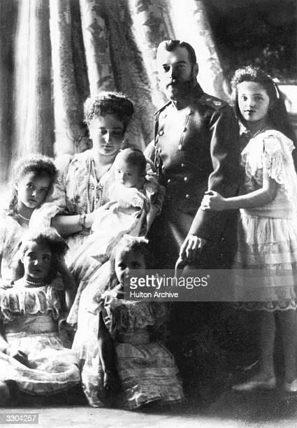 Tsar Nicholas II of Russia with his wife Alexandra Feodorovna and their five children Empress Alexandra holds the baby Tsarevich Alexis surrounded by...