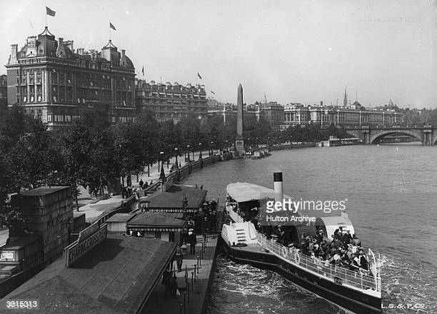A paddle steamer on the River Thames at Charing Cross Pier Cleopatra's Needle can be seen in the background