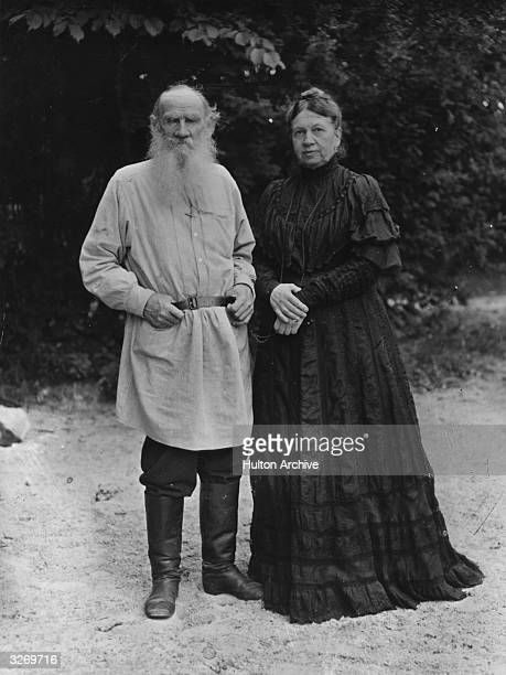Russian writer Leo Tolstoy in the garden of his Russian home with his wife Sonya .