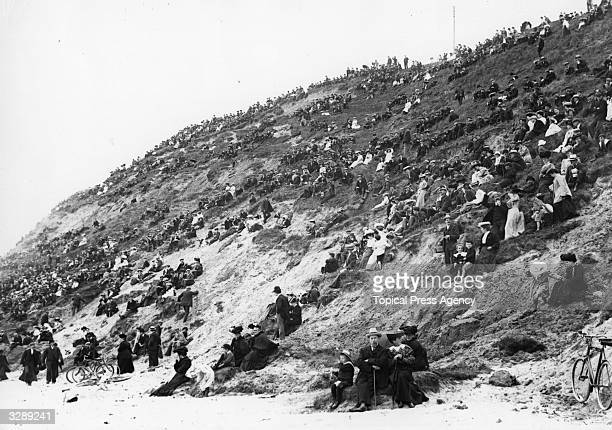 A crowd of day trippers sitting on the cliffs at Saltburn Yorkshire