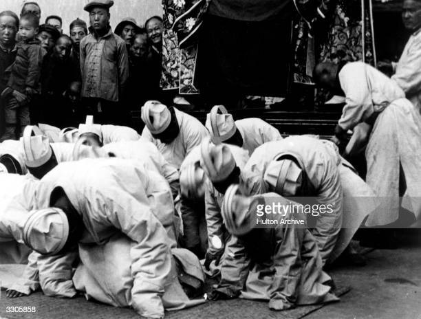 Mourners at the funeral of the Dowager Empress of China