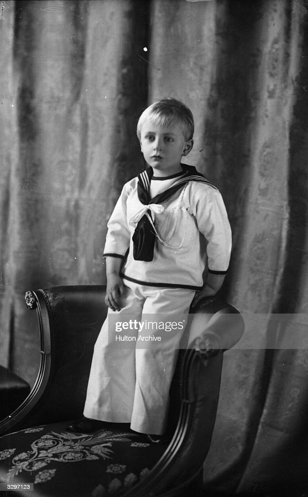 Olav, son of King Haakon VII , Crown Prince of Norway, later Olav V (1903 - 1991) as a very small boy in a sailor suit.