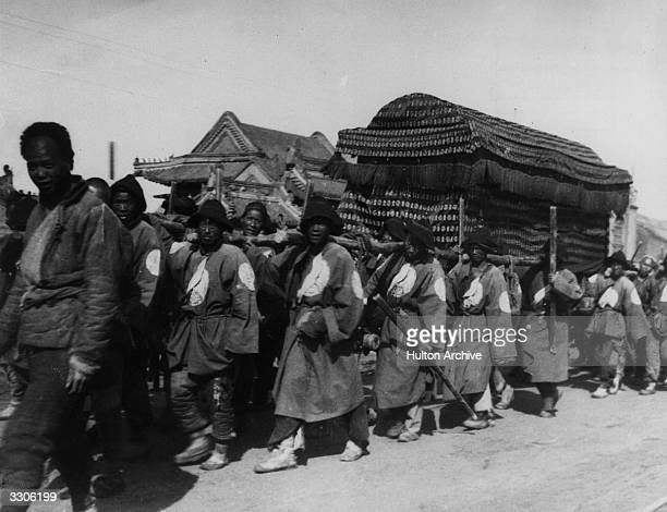 Possibly the funeral cortege of the Empress Dowager of China