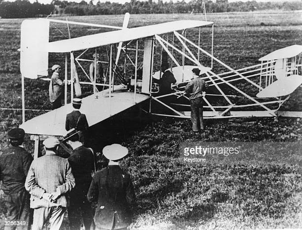 The brothers Orville and Wilbur Wright pioneers in the field of military aviation demonstrate one of their earliest planes at Le Mans Their work was...