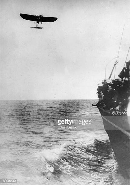 French Aviator Louis Bleriot the first pilot to fly from Calais to Dover in a monoplane flies across the English Channel