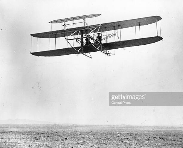 Grace pilots a bi-plane, designed by Wilbur Wright, , and his brother Orville Wright, , the US aviation pioneers who designed and flew the world's...