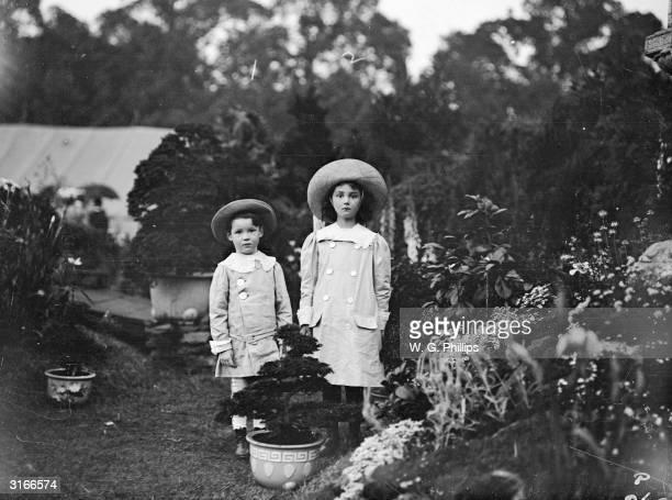 Two little girls dressed in Edwardian daywear.