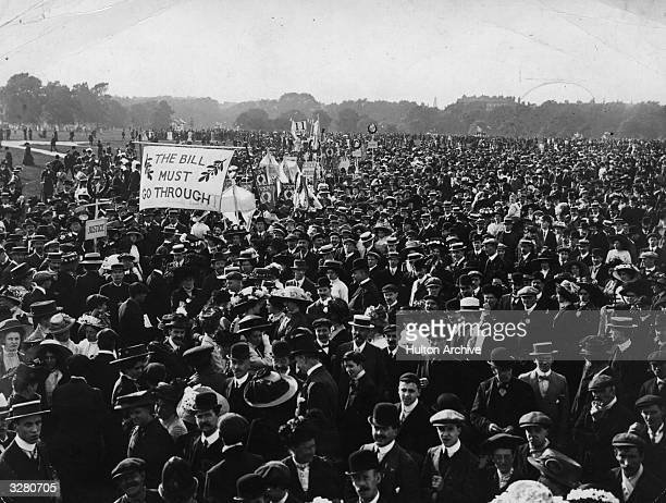 A crowd in Hyde Park at a suffragette meeting