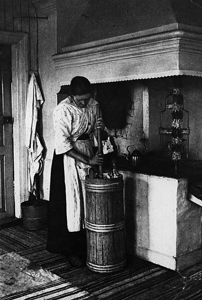 A Finnish woman makes butter in her kitchen.