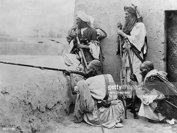 A group of Afghans armed with rifles in the Khyber Pass