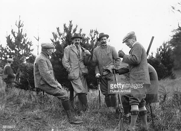 Group of Edwardian gentleman relaxing on a pheasant shoot.
