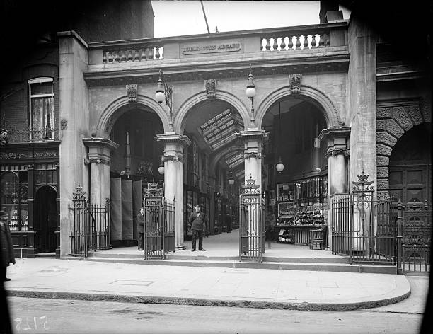 A security guard stands in one of the arched entrances...