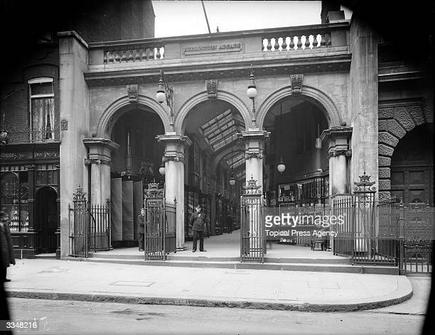 A security guard stands in one of the arched entrances to Burlington Arcade Piccadilly London