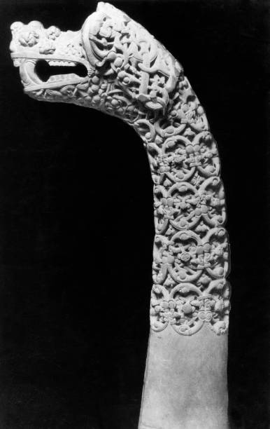 An elaborately carved dragon's head post found in the...