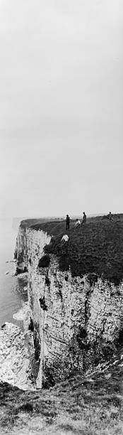 Cliff climbers searching for gulls' eggs at Bempton...