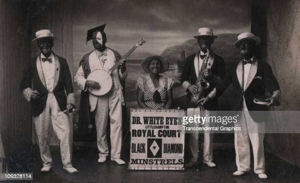 LITTLEHAMPTON ENGLAND circa 1910 Four older men and a grinning woman perform in costume and racist blackface as the Black Diamond Dr White Eyes...