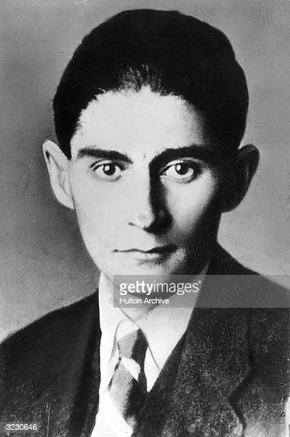 Headshot Portrait Of Austrian Writer Franz Kafka As A Young Man In Jacket And Tie