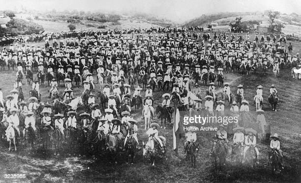 Mexican revolutionaries Pancho Villa and Emiliano Zapata assemble with their army of peasants and farmers on horseback, Mexico.