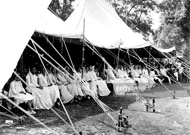 Parsee women watch a cricket match in India