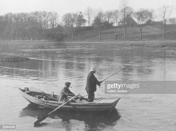 Two men in a boat fishing on the River Tweed in the Scottish borders The Tweed is famous for its trout and salmon Wild salmon are an important part...