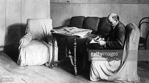Vladimir Ilyich Lenin sitting and writing in austere surroundings