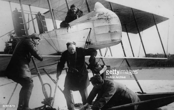 Winston Leonard Spencer Churchill British Statesman and Prime Minister leaving sea plane after inspecting the Fleet from the air
