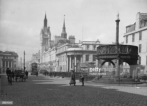 A view of Aberdeen with Market Cross on right and Municipal Buildings behind Aberdeen situated on the North Sea is known as the Granite City because...