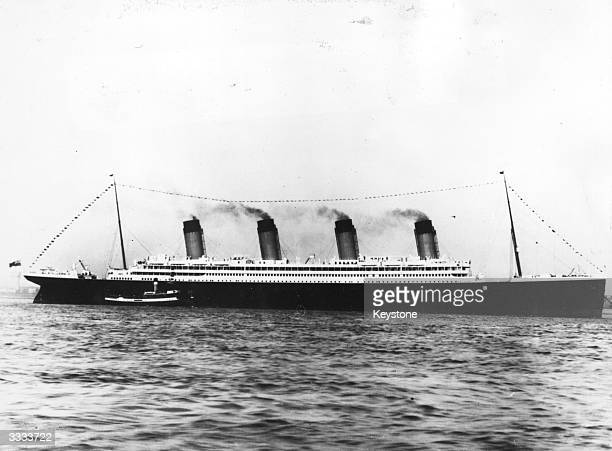 The White Star liner Olympic' sister ship to the Titanic dressed with signal flags