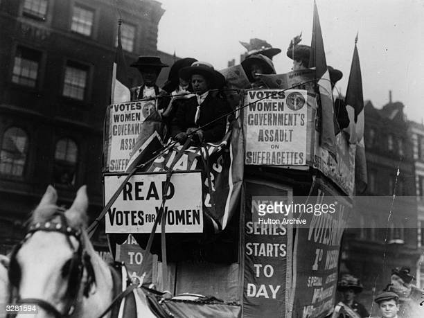 A horse drawn campaign van driven by the suffragettes advertising the newsheet 'Votes For Women'