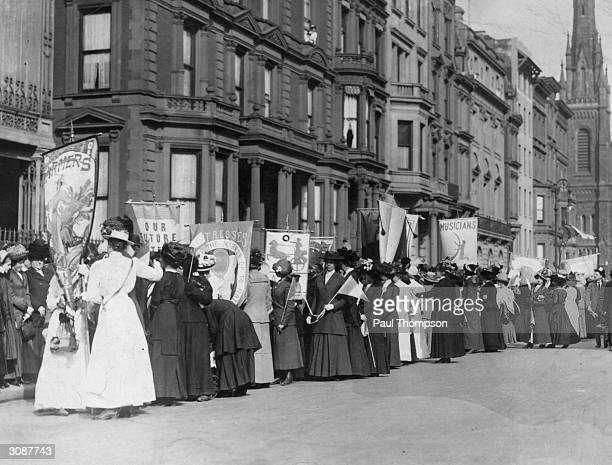 A crowd of women representing the various professions on a Women's Suffrage Movement parade through New York City